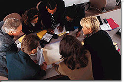 Photo of group working together on a project